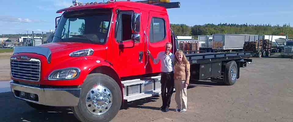 Large red tow truck and couple